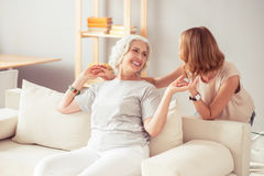 Overjoyed smiling woman resting at home with her daughter Royalty Free Stock Photo