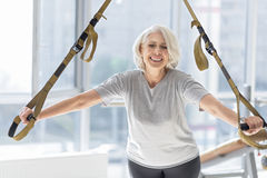 Overjoyed smiling woman training with special sport equipment. Royalty Free Stock Images