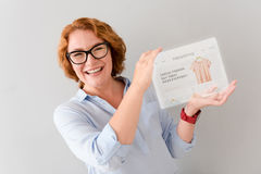 Overjoyed smiling womna showing tablet Stock Images