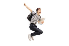 Overjoyed teenage student jumping and gesturing happiness. Isolated on white background Stock Image