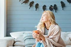 Overjoyed woman drinking coffee in cozy bedroom Stock Image
