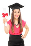 An overjoyed woman holding a diploma Stock Image