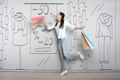 Overjoyed woman smiling after shopping Stock Images