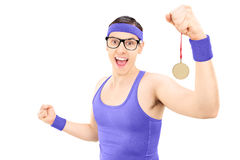 Overjoyed young athlete holding a medal Stock Photography