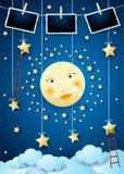Overklig natt med fullmånen, stegar och fotoramar royaltyfria bilder