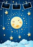 Overklig natt med månen, hängande stjärnor och fotoramar royaltyfri foto