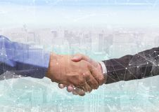 overlap: city and foreground of handshake. stock images