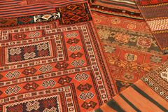 Overlapping carpets with intricate Kurdish  patterns Stock Photo