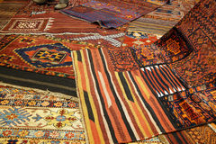 Overlapping carpets with intricate Kurdish  patterns Royalty Free Stock Photography