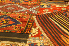 Overlapping carpets with intricate Kurdish  patterns Royalty Free Stock Photo