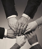 Overlapping executive hands Stock Photo