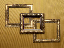 Overlapping frames on gold Stock Photo