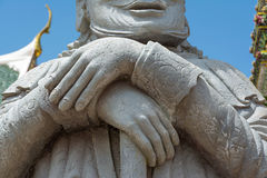 Overlapping hands of stone giant in temple Stock Photography