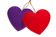 Overlapping Hearts. Red & purple Fabric Overlapping Hearts isolated on white royalty free stock image
