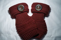 Overlapping maroon fingerless knitted gloves Stock Photography