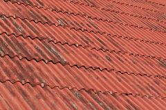 Overlapping the roof with undulating sheet material. Such as slate Stock Photography