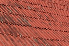 Overlapping the roof with undulating sheet material. Such as slate Stock Image