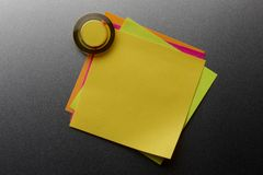 Overlapping stickies. Four colorful blank stickies tacked onto metal surface with magnet Royalty Free Stock Photography