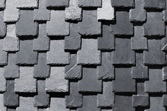 Overlapping stone slabs on a roof. Tiled shingle background Stock Photography