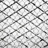 Overlapping of two different wire netting Royalty Free Stock Photography