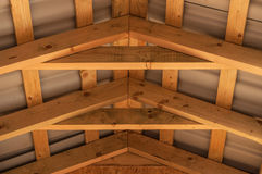 Roof joist wood construction. Bottom view on the joists overlaps and roof inside the new house under construction Stock Images