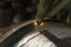Overlay welding hard surfacing of steel roll by submerge arc wel Royalty Free Stock Photography