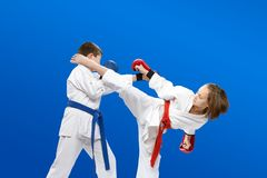 With overlays on the hands the children are beating karate blows. With overlays on the hands children are beating blows Royalty Free Stock Image