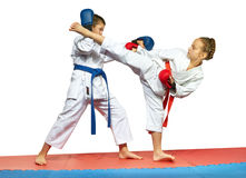 With overlays on the hands two athletes are training kick leg and protection Stock Images