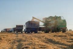 Overload of grain harvester Stock Image