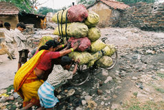 Overloaded bicycle, India. People taking coking coal to the market, Jharia, Jarkhand, India Stock Photos
