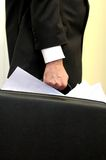 Overloaded briefcase. Businessman holding briefcase overloaded with documents Stock Images