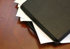 Overloaded briefcase. Briefcase overloaded with documents, business meeting concept Stock Image