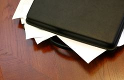Overloaded briefcase. Briefcase overloaded with documents, business meeting concept Stock Images