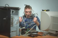 Computer repairman. Computer technician engineer. Support service. Overloaded computer repairman tired from his work and goes crazy. Computer technician. PC Stock Image