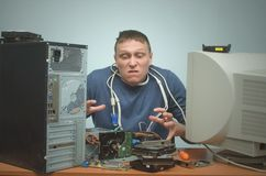 Computer repairman. Computer technician engineer. Support service. Overloaded computer repairman tired from his work and goes crazy. Computer technician. PC Stock Photos