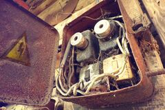 Free Overloaded Electrical Circuit Causing Electrical Short And Fire. Old Electric Power Supply Boxes. Industrial Background. Royalty Free Stock Photo - 171040125