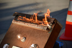 Overloaded electrical circuit causing electrical short and fire. Stock Image