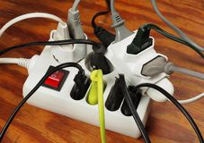 Overloaded extension cord Stock Photo