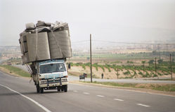 Overloaded lorry in Syria. Overloaded lorry travels the Damascus-Aleppo highway in western Syria stock images