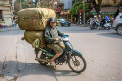 Overloaded motorbike on the streets of Hanoi Stock Photo