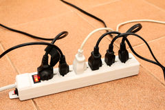 Overloaded power boards outlet multiple socket electrical plug Royalty Free Stock Image