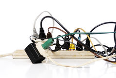 Overloaded power strip. Power strip and extension cord jumble Royalty Free Stock Photos