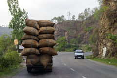 Overloaded vehicle a common sight on street of New Delhi, India. Stock Photo