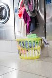 Overloaded Washing Machine And Laundry Basket Royalty Free Stock Photo