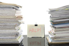 Overloaded work. Stack of document on working desk in office, for overload work and help needed Royalty Free Stock Photos
