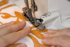 Overlock sewing machine in use Royalty Free Stock Images
