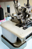 Overlock sewing machineon the work table close up Royalty Free Stock Images