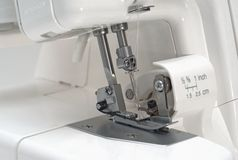 Overlock sewing machinery closeup Royalty Free Stock Images