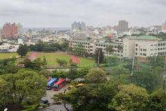 Overlook the athletic field of meilun junior high school in rain Stock Images
