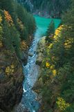 An overlook gives an epic view of a rushing stream as it flows into Gorge Lake stock images